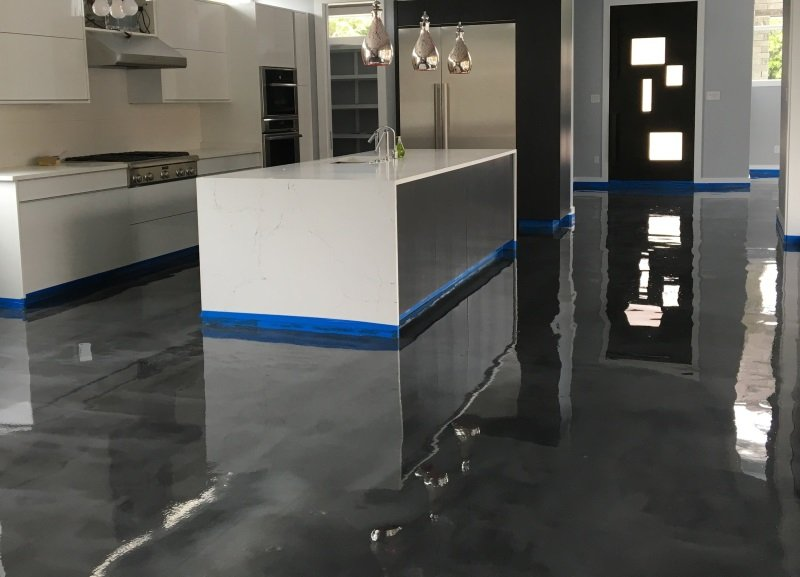 Epoxy floor painting contractor that installs metallic and reflector epoxy flooring in garages and commercial spaces